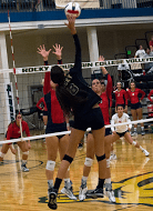 Junior Mariah Stiffarm reaches to spike the volleyball onto the opposing side of the court.  photo by Brandon Keim