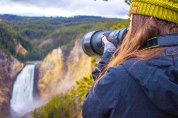 Senior, Paige Bailey Behner photographs the Lower Falls in the Grand Canyon of Yellowstone. Photo courtesy of Nicolas Cordero