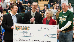 Rocky Mountain College athletic director Bruce Parker, head men's basket- ball coach Bill Dreikosen, and head women's basketball coach Wes Keller present a donation to Ronald McDonald House Charities before the men's basketball game on February 4th, 2017, at the Fortin Fitness Center on campus. Photo by Ean McLaughlin.