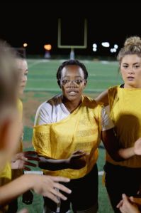 Lowerclassmen huddle during the powderpuff game - Homecoming September 2021