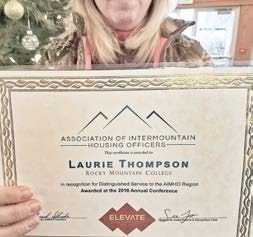 Thompson with her award from the Association of Intermountain Housing Officers. Photo courtesy of Thompson.