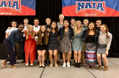 RMC Men's and Women's XC teams pose for a photo at the NAIA National Championship. Photo by Coach Mackenzie O'Dore.