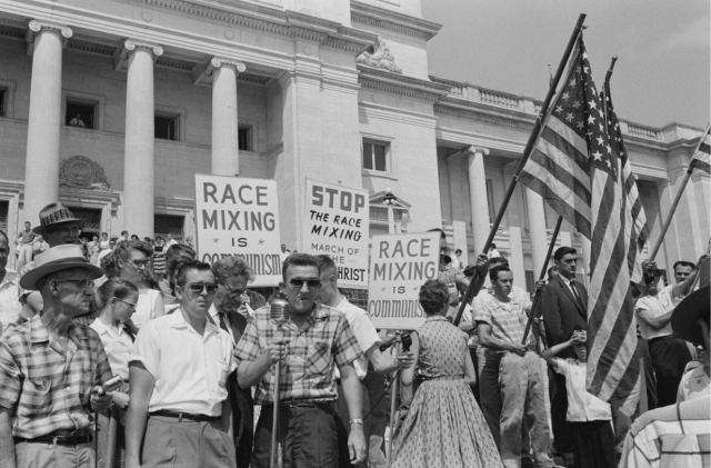Photo of protests against the integration of the Little Rock Nine. Image by John T. Bledsoe
