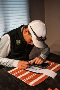 After the tournament, I drive home and complete my post-round analysis which after 5-6 hours on the course can be a long process. After teeing off at 11, it is now about 5 o'clock. The analysis consists of counting how I played, how many putts I made, etc. From Oliver Walker's Tournament Day photo story