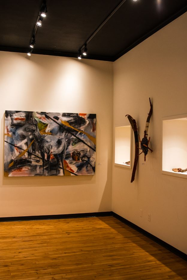 """Photo featuring Baken's """"Cowboy Elk"""" mixed-media work and more clubs made in the Bitterroot Mountains of MT"""