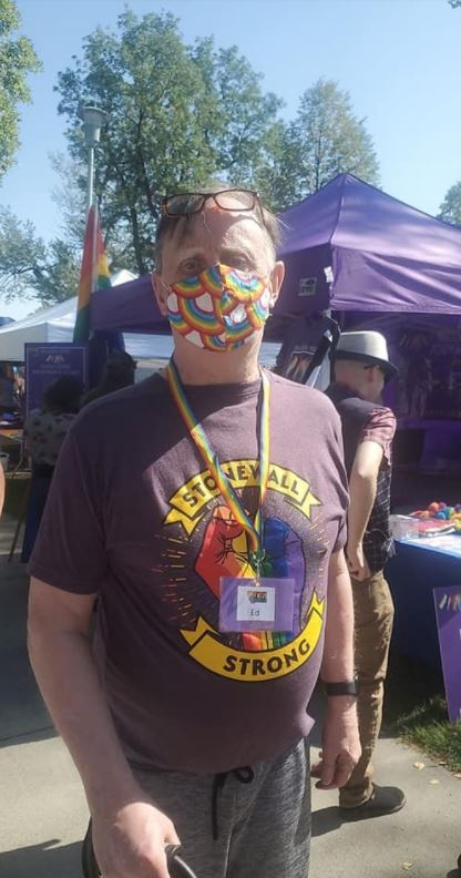 """One of the PRIDE booth organizers sports his """"Stonewall Strong"""" T-shirt while making his rounds through the other booths and directing the Pride attendees."""