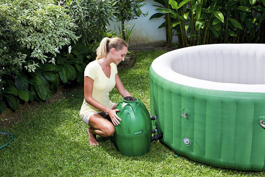 A woman installing an inflatable hot tub