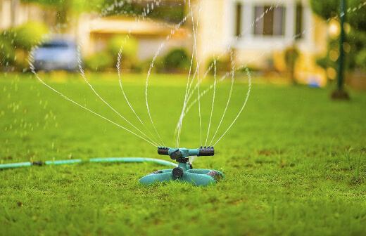 After you overseed lawn areas, water gently until the first 2 inches of soil are wet