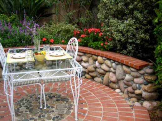 Brick patio can be made more captivating by utilizing bricks in different colors