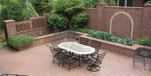 There are various materials that pair well with brick and can be used to declare the aesthetic theme of a patio