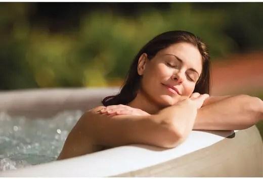 Woman enjoying the benefits of hot tubs