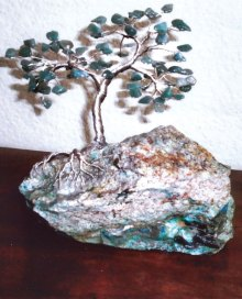 A memorial jade Ming tree; Lapidary Club member Chet Howe created this Ming Tree using jade stones for the leaves on a base of green kryptonite as a memorial gift for the family of long-time club member Violet Williams.