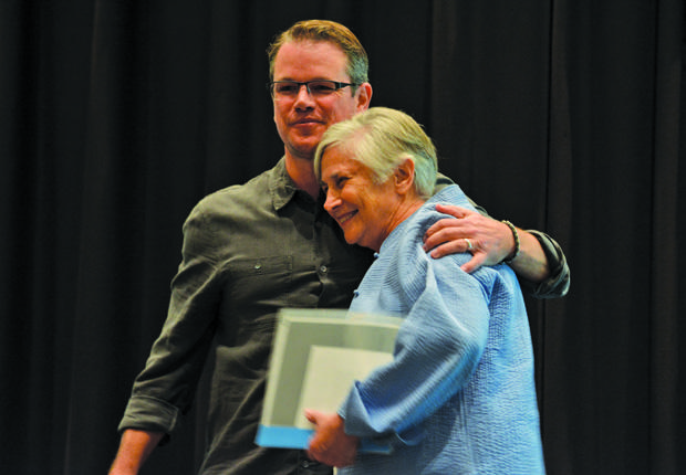 "Matt Damon and Dr. Diane Ravitch embrace at the ""Education on Edge"" speaker series. Dr. Ravitch an avid advocate for education, spoke of her experiences and promoted her book ""The Reign of Error."""