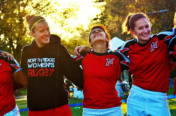 Claire Bauer (Left), a senior kinesiology major, Evelyn Avila (Middle), a senior kinesiology major and Katie Kargari (Right), a junior art major lock arms and reflect on the game and how well they did. Photo credit: Laura Pierson / Contributor
