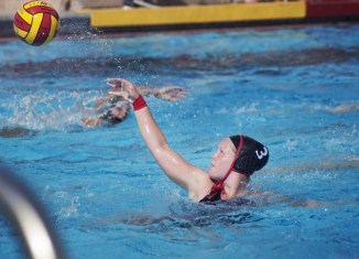 Student water polo athlete throws ball