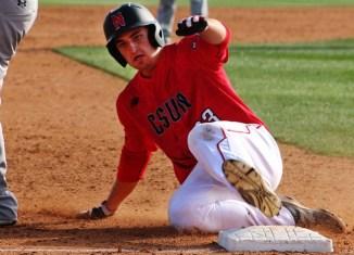 Baseball player slides into base