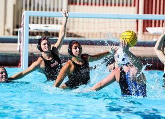 CSUN water polo athletes defend goal
