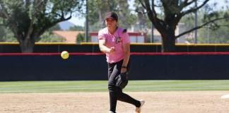 CSUN softball player pitches ball