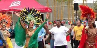 Students dance along Brazilian dancers in costume