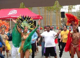 Students dance along Brazilian dancers in costume