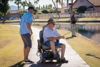 Pictured are Brad Smith, an IronOaks resident, and a disabled veteran fishing at the East Lake.