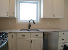 Kitchen fixtures plumbing susan compagner west for Kitchen cabinets zeeland mi