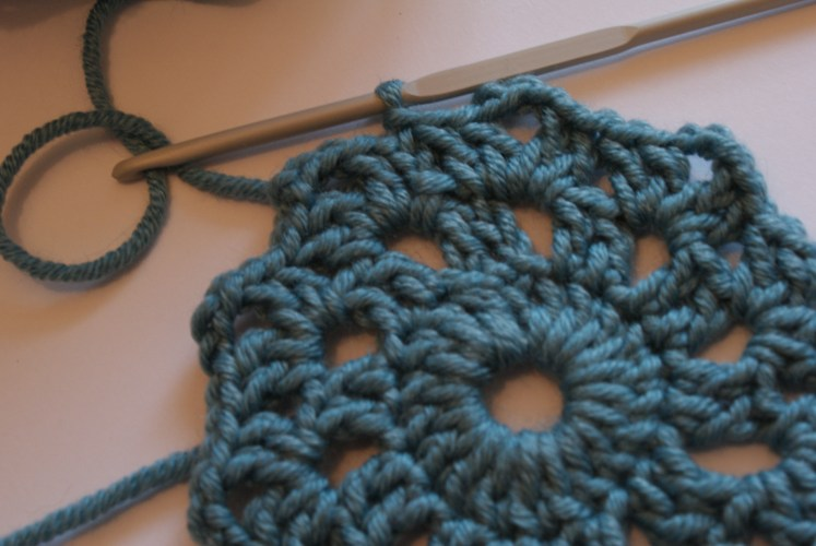 Crocheted coaster being finished off