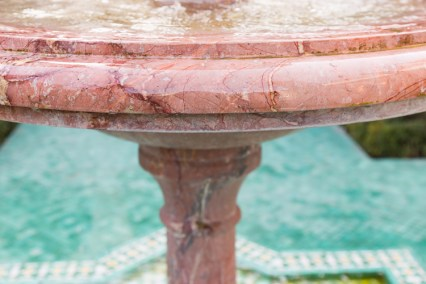 Pink marble water fountain in courtyard at Le Grand Mosque