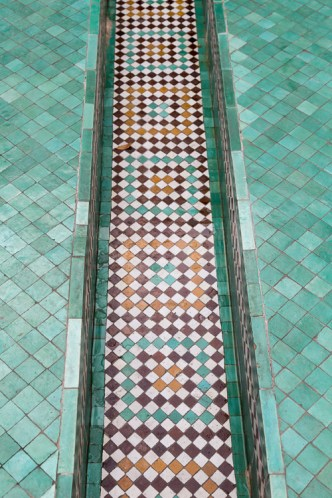 Colorful tiled trough for flowing water