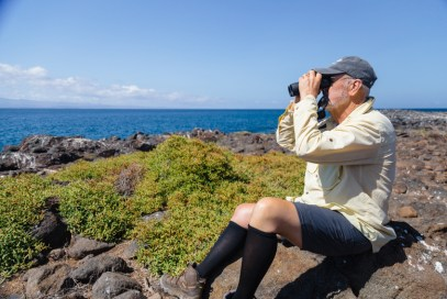 Birdwatcher Looking Through Binoculars on Seymour Island