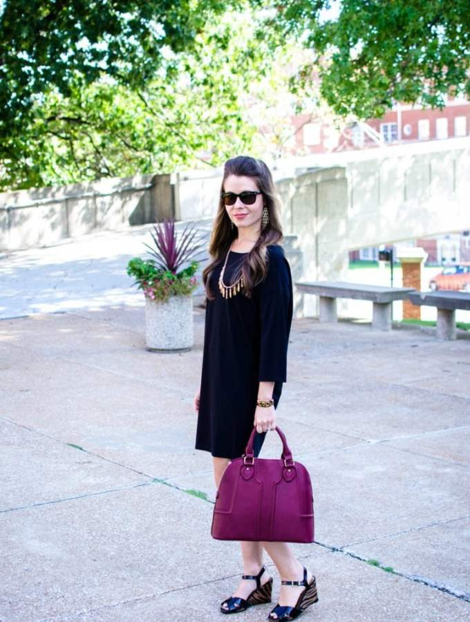 This edition of Sweet Chic features a dolman sleeve little black dress that's perfect for fall. It's paired with a wine-colored satchel bag and animal print wedges for a chic street-style outfit.