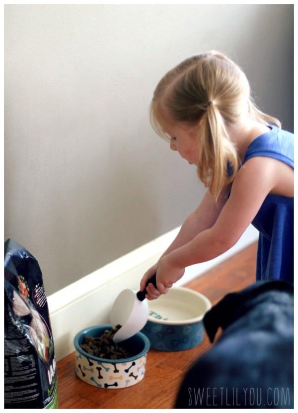 Avery feeding Daisy
