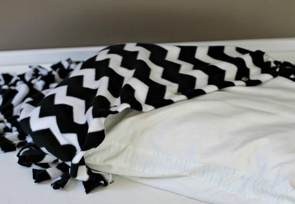 Stuff the pillow inside the blanket