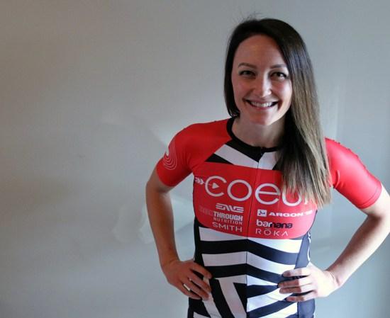 smiling woman wearing coeur sports team kit