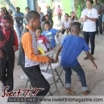 Boys play musical chairs at special needs children Easter Bonnet parade at Queen's Park Cricket Club, color eggs, Sweet T&T, Sweet TnT, Trinidad and Tobago, Trini,