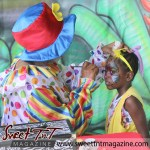 Clown paints girl's face with butterfly at special needs children Easter Bonnet parade at Queen's Park Cricket Club, color eggs, Sweet T&T, Sweet TnT, Trinidad and Tobago, Trini, vacation, travel