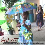Girl in blue dress, special needs children at Easter Bonnet parade at Queen's Park Cricket Club, disney characters on umbrella, Sweet T&T, Sweet TnT, Trinidad and Tobago, Trini,