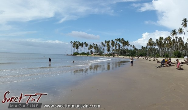Icacos shore trees people blue sky by Marika Mohammed for story Icacos end of Trinidad in Sweet T&T, Sweet TnT, Trinidad and Tobago, Trini, vacation, travel