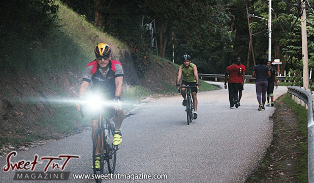 2 cyclists and 2 women and 2 men walk exercising on Lady Chancellor Hill Port of Spain for story original outdoor gym in Sweet T&T, Sweet TnT, Trinidad and Tobago, Trini, vacation, travel