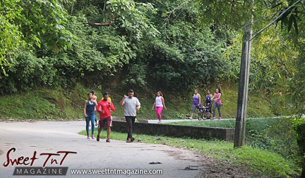 9 women and men and baby in stroller exercising on Lady Chancellor Hill Port of Spain for story original outdoor gym in Sweet T&T, Sweet TnT, Trinidad and Tobago, Trini, vacation, travel