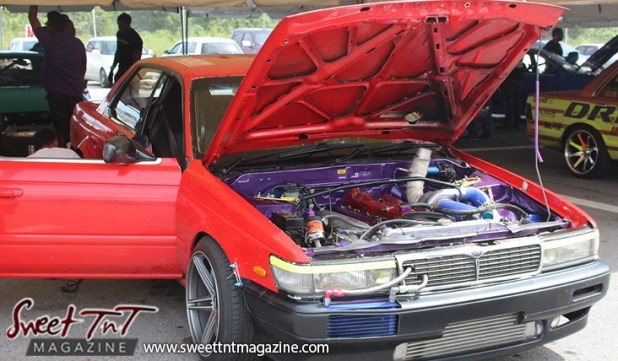 Purple engine red car for Drifters in Wallerfield article by Marika Mohammed in sweet T&T for Sweet TnT Magazine, Culturama Publishing Company, for news in Trinidad, in Port of Spain, Trinidad and Tobago, with positive how to photography.