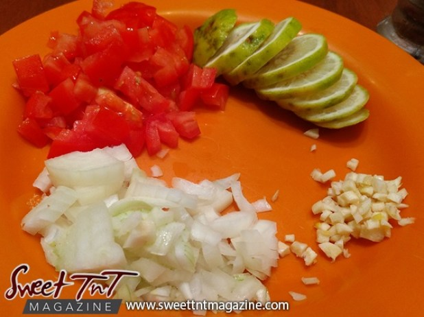 Swai seasoning onion tomatoes limes garlic in sweet T&T for Sweet TnT Magazine, Culturama Publishing Company, for news in Trinidad, in Port of Spain, Trinidad and Tobago, with positive how to photography.