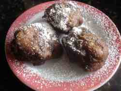 Apple Fritters dusted with powdered sugar