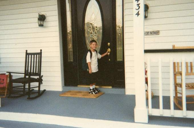 Tyler first day of first grade on the front porch.