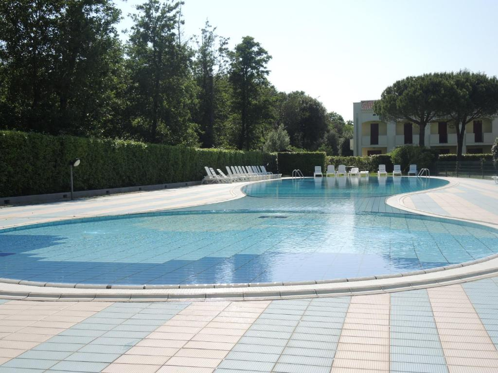 Pool Garten Untergrund Apartment Nettuno Bibione Italy Booking