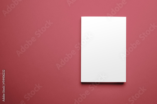 Blank magazine cover template on red background with clipping path