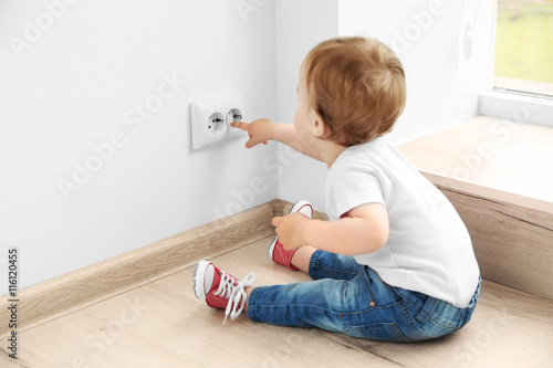 Quotbaby Playing With Electrical Outlet On Floor At Homequot Stock Photo And Royalty Free Images On
