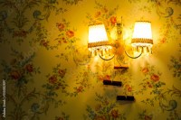 """""""Illuminating lamp attached to the wall with wallpaper ..."""