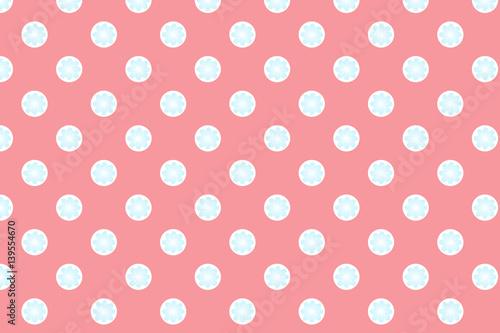Pink polka dot background with blue flower inside\