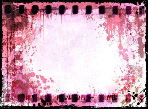 Vintage red film strip frame on old and damaged fabric background